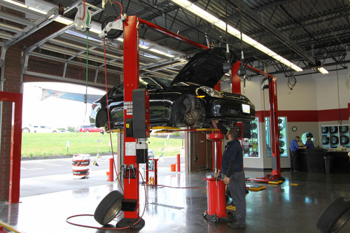 Like many tire retailers, Tire Discounters used to rely on mid-rise or low-rise lifts for tire work, which drastically limited the services that could be performed in those bays. Now every new and renovated Tire Discounters store gets outfitted with Rotary Lift Shockwave-equipped two-post lifts. As the world's fastest lifts, Shockwave-equipped lifts enable technicians to perform virtually any maintenance or repair service in every bay quickly, resulting in what the company calls a huge improvement in service efficiency.  (PRNewsFoto/Rotary  ...