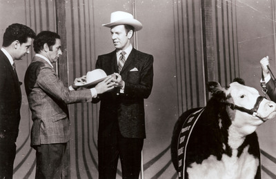Robert J. O'Brien, Sr. (right), now Chairman Emeritus of R.J. O'Brien & Associates (RJO), appears on the Tonight Show with Joey Bishop and Regis Philbin (left) with the Grand Champion Western Steer to promote the Chicago Mercantile Exchange's Live Cattle futures contract in 1968. O'Brien was Chairman of CME in 1967 and 1968. RJO, the oldest and largest independent futures brokerage and clearing firm, kicked off its Centennial celebration this week.  (PRNewsFoto/R.J. O'Brien & Associates)