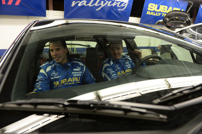 David Higgins and co-driver Craig Drew checking out their future rally office, the 2015 WRX STI. (PRNewsFoto/Subaru of America, Inc.)