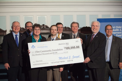 (Left to Right, individuals holding the check) President of the Community Foundation of Greater Flint Kathi Horton; Lieutenant Governor of Michigan Brian Calley; and Grand Master of Michigan Masons Richard Wisely. (Left to Right, individuals in the back row) Senator Rick Jones; Senator Jim Ananich;  President of the Michigan Masonic Charitable Foundation  Fred Kaiser;  Representative Ken Goike and Representative Charles Smiley. Photo courtesy of the Community Foundation of Greater Flint.