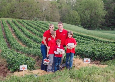 Tyler and Harriet Wegmeyer, pose with their three children in front of a strawberry field. Wegmeyer Farms was the winner of the 2016 Bayer Young Farmer Sustainability Award.