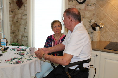 Gregory Gedovin, 70, talks with registered nurse Michelle Cooper, who was sent to his home by his Medicare Advantage health plan, WellCare of Texas. The visit is part of WellCare's new field-based care management program, designed to deliver personalized, cost-efficient care for medically-complex Medicare Advantage members.