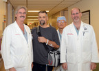 In July 2011, during a 12-day period, Texas Heart Institute performed its first four implants of the SynCardia Total Artificial Heart. L to R: Dr. Igor Gregoric, Total Artificial Heart patient Ken Woychesin, Dr. Jonathan Ho and Steven Parnis.  (PRNewsFoto/SynCardia Systems, Inc.)