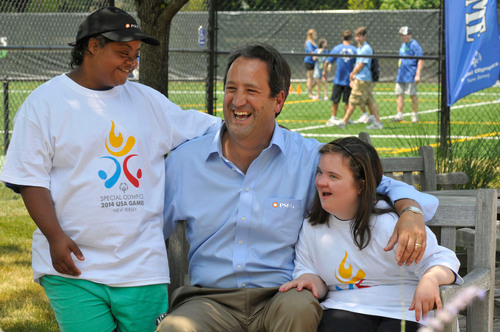 Ralph LaRossa, President & COO of PSE&G, the 2014 Special Olympics USA Games' newest Founding Partner, celebrates with Special Olympics athletes Velinda Ramsey of Trenton, NJ and Megan Clark of Mercerville, NJ. PSE&G will Serve as Presenting Sponsor of the Games' Youth Leadership Initiative. The 2014 USA Games are expected to involve 80,000 people and bring $50 million in economic activity to the New Jersey area.  (PRNewsFoto/2014 Special Olympics USA Games)
