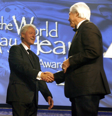 Bill Austin, founder, Starkey Hearing Foundation (right) introduces evening honoree President Bill Clinton (left) at the Foundation's 11th annual So The World May Hear Gala in Saint Paul, Minnesota.   (PRNewsFoto/Starkey Hearing Foundation)