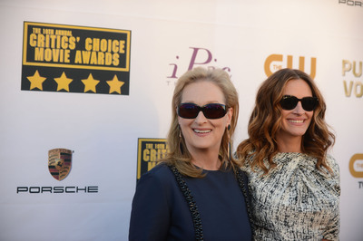 Meryl Streep and Julia Roberts attend the 19th annual Critics' Choice Movie Awards presented by Porsche at The Barker Hangar in Santa Monica on Thursday, Jan. 16, 2014.   (PRNewsFoto/Porsche Cars North America, Inc.)
