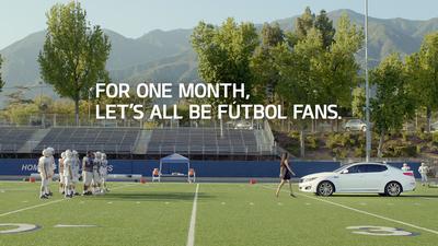 "Supermodel Adriana Lima and Kia Motors America turn curious onlookers into ""Futbol"" fanatics in series of ads celebrating the 2014 FIFA World Cup Brazil(TM) (PRNewsFoto/Kia Motors America)"
