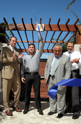 Aimco Executive Vice President John Bezzant, Miami Beach Commissioner Michael Gongora, Miami Beach City Manager Jimmy L. Morales, and Assistant City Manager Jorge Gomez cut the ribbon to open a new, public section of the Baywalk at a ceremony at Aimco's Flamingo South Beach Apartments.  (PRNewsFoto/Aimco)