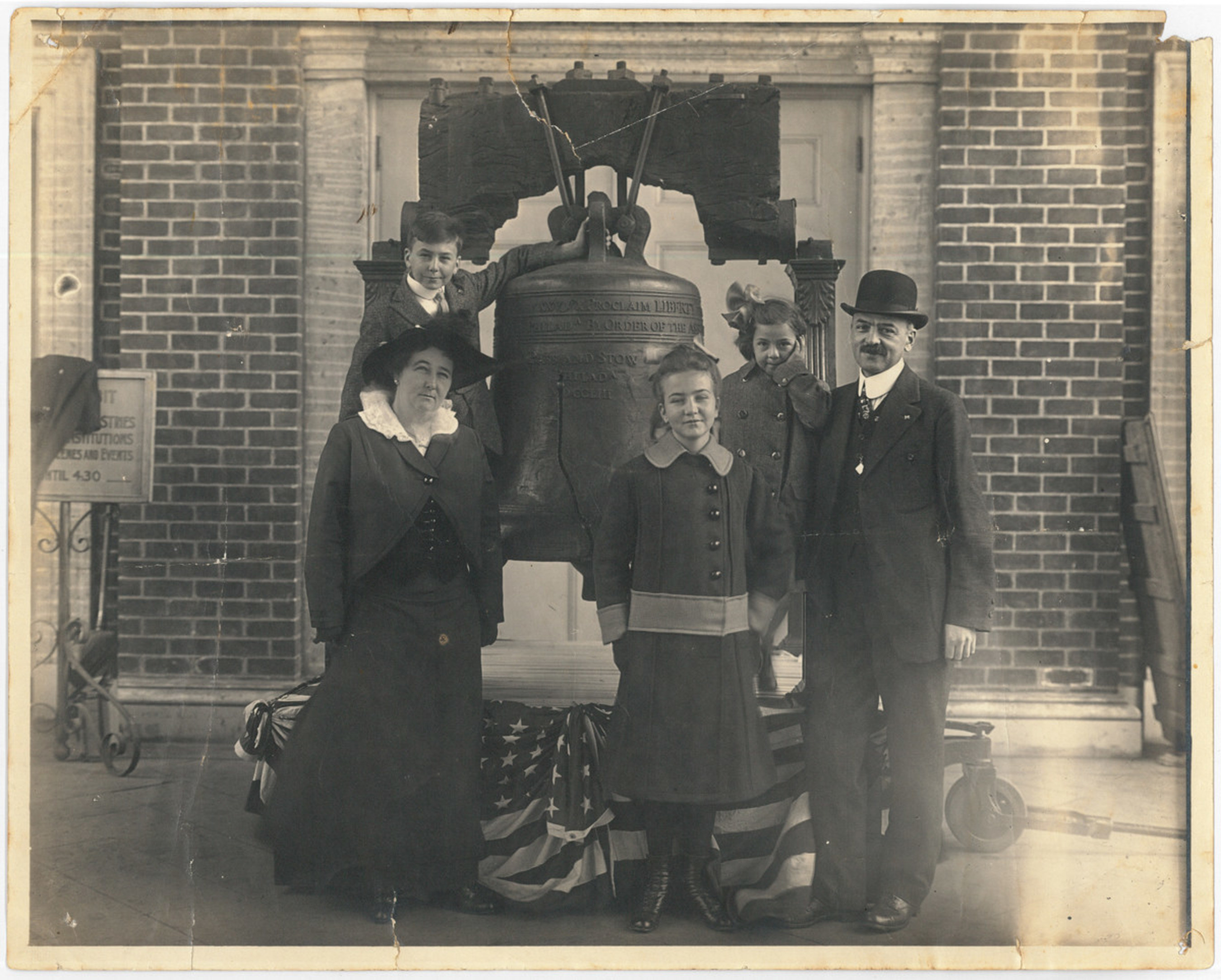 Angelo Joseph Rossi family clustered around the Liberty Bell.