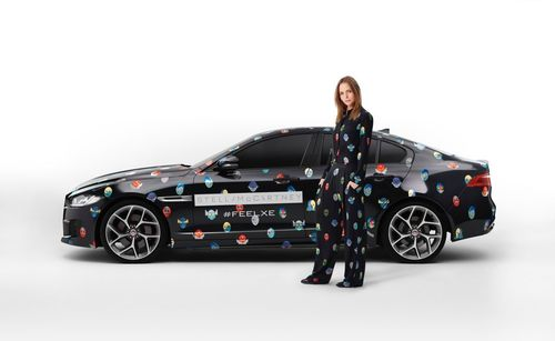 JAGUAR AND STELLA MCCARTNEY BRING THE NEW XE TO PARIS - Stella to dress fleet of Jaguar vehicles in her Spring 2015 Superhero print to mark the next phase in the Jaguar XE reveal at the Paris Motor Show on 2 October (PRNewsFoto/Jaguar)