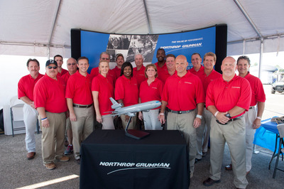 Northrop Grumman Lake Charles Maintenance and Modification Center employees pose in front of the company's booth at the Chennault International Airshow in Lake Charles, La.  Northrop Grumman was a premier sponsor of the show held Sept. 28 and 29.   (PRNewsFoto/Northrop Grumman Corporation)