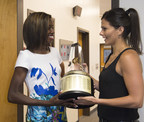 Candace Hill, left, of Rockdale County High School, is surprised with the 2014-15 Gatorade National Girls Track & Field Athlete of the Year trophy by Gatorade Marketing Manager Keri Lockett, Thursday, June 25, 2015 in Conyers, GA. The award recognizes outstanding athletic excellence as well as high standards of academic achievement and exemplary character demonstrated on and off the field. Photo/Gatorade, Susan Goldman, handout.