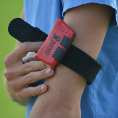 Athletes wear the Body Module on their arm or waist and it measures intricate metrics about speed and velocity. (PRNewsFoto/XBand)