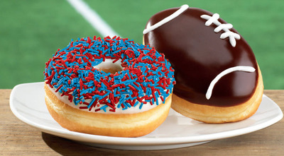 Tim Hortons Cafe & Bake Shop's Limited Time Only Game Day Donuts, featured are the Football and Vanilla Dip Team Sprinkle Donut. Available at all U.S. restaurants.  (PRNewsFoto/Tim Hortons)