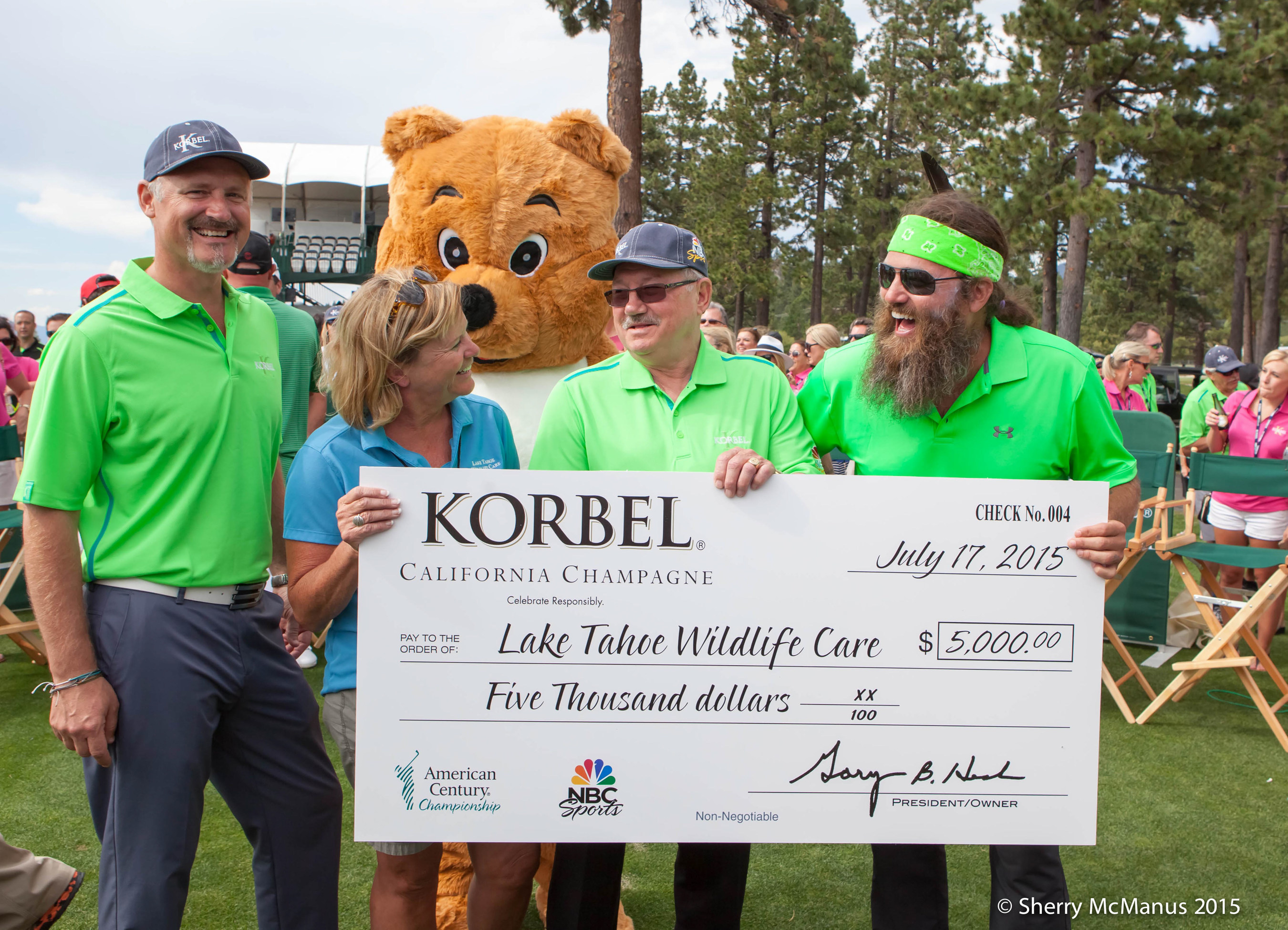 On July 17th 13 of the world's most legendary athletes and entertainers competed in Lake Tahoe for the Korbel Closest-to-the-Pin Challenge as part of the American Century Celebrity Golf Championship, currently being played at Edgewood Golf Course. Duck Dynasty Star Willie Robertson took home the title, winning a $5,000 donation from the  for the Tahoe Wildlife Care from the Korbel Toast Life Foundation. Pictured L-R: Todd Kennedy, Korbel; Sue Novasel, District Five Supervisor; Gary Heck, Korbel; Willie Robertson, Duck Dynasty