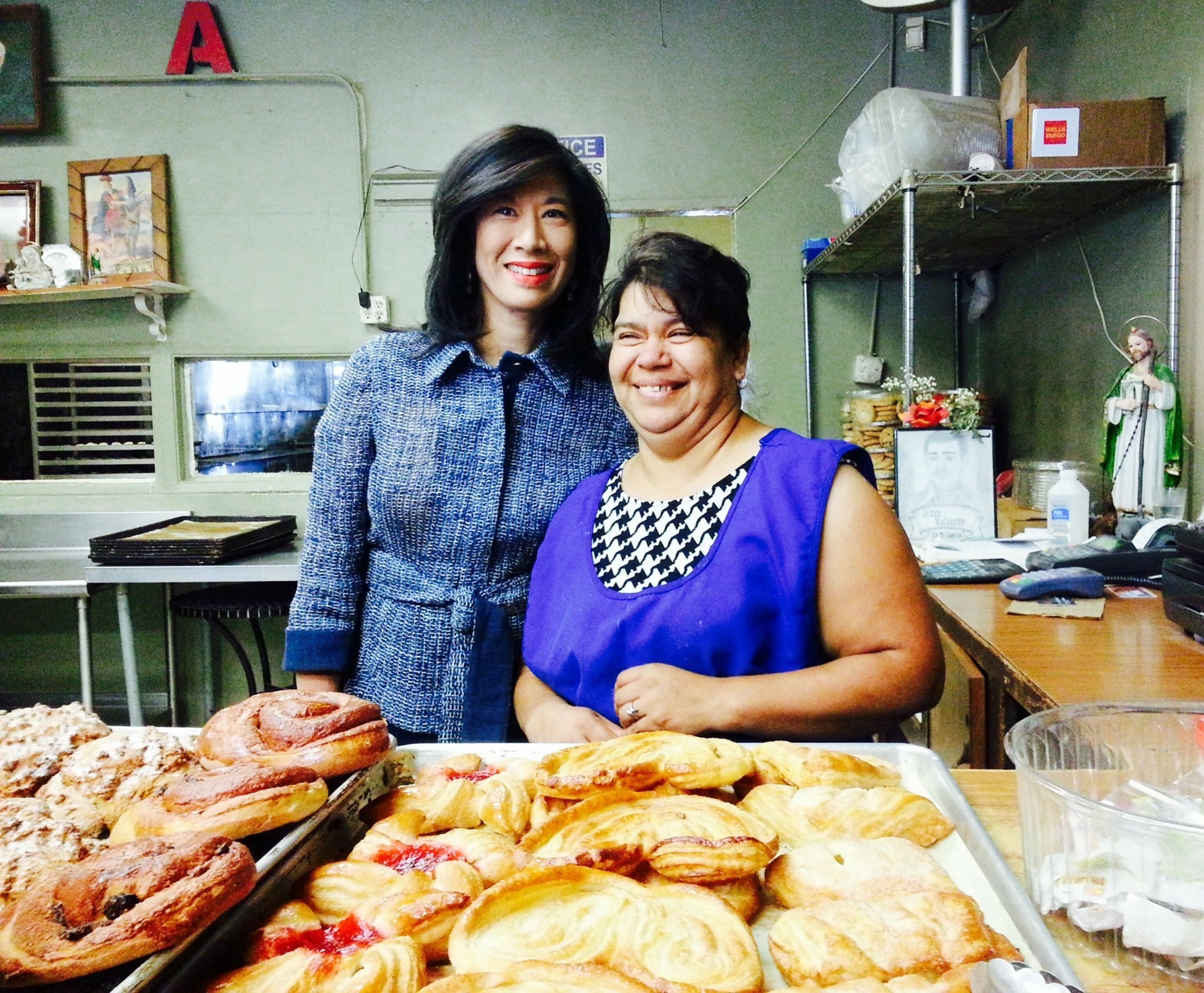 Grameen America CEO Andrea Jung with Bertha, a baker in Los Angeles who is growing her business thanks to a microloan from Grameen America.