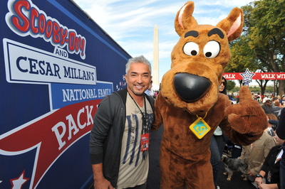 Cesar Millan and Scooby-Doo take over the National Mall at the Second Annual National Family Pack Walk on Saturday Sept. 29, 2012, in Washington. (PRNewsFoto/Larry French/Invision for Warner Bros. Consumer Products/AP Images)