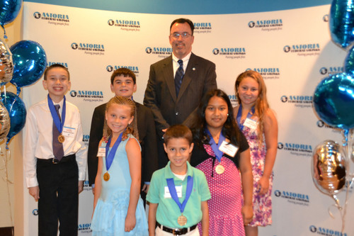 Astoria Federal Savings Essay Contest top winners display their awards at a ceremony held in July at Astoria ...