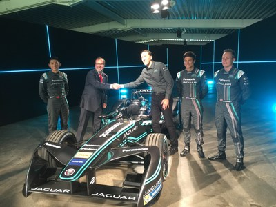 Lear vice president, E-Systems Europe & Africa, Mariano de Torres at center left shaking hands with Panasonic Jaguar racing team director James Barclay with drivers Ho-Pin Tung, Mitch Evans, and Adam Carroll.