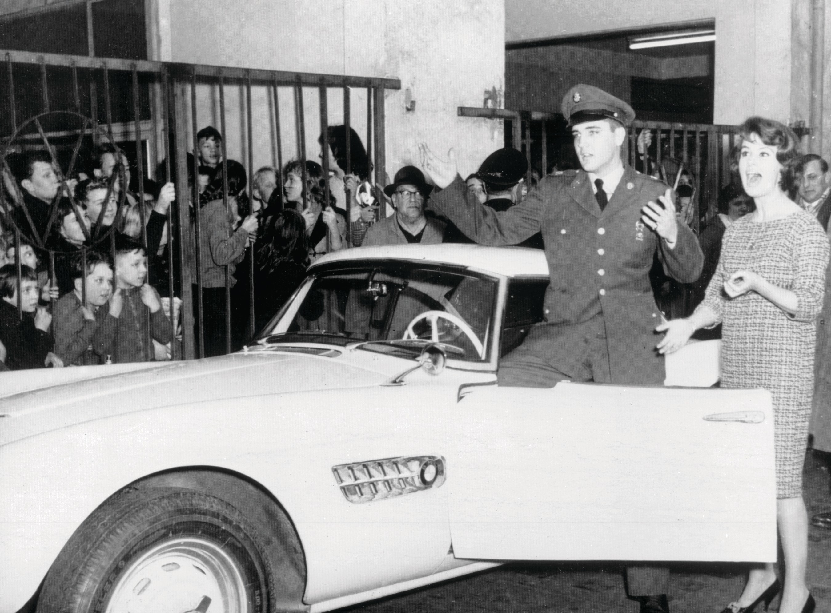 Elvis Presley in front of his BMW 507. Copyright (C) BMW AG. (Use approved for press purposes only)