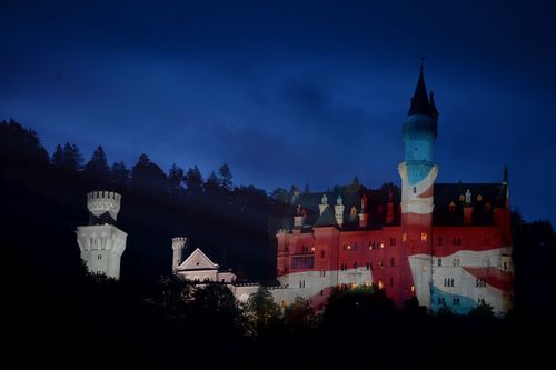 The Free State of Bavaria welcomes Prime Minister David Cameron to the G7 summit by illuminating Neuschwanstein Castle in the colours of the Union Jack. (PRNewsFoto/Bayerische Staatskanzlei)