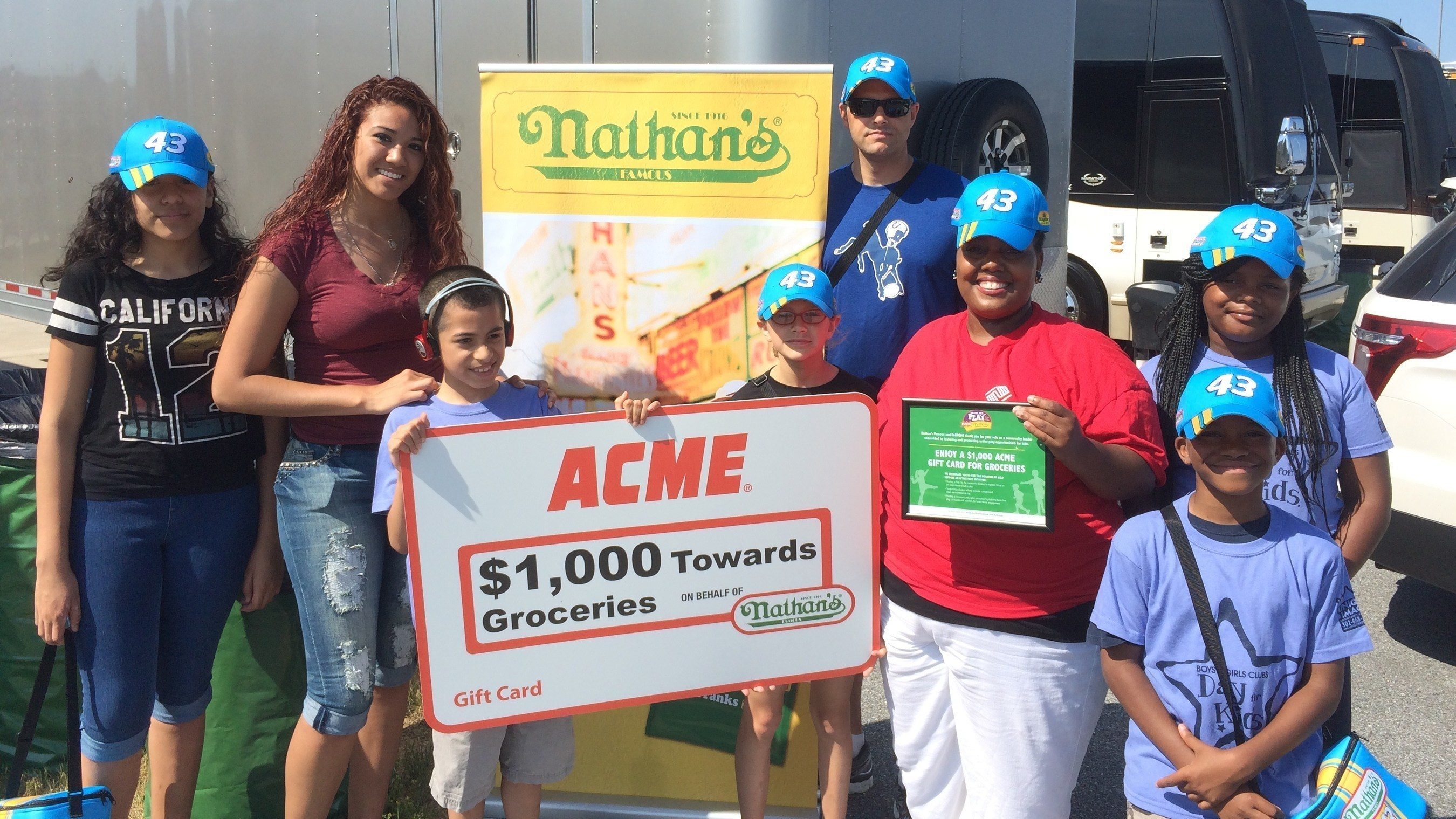Nathan's Famous presented representatives from the Boys and Girls Clubs of Delaware in Milford with an ACME gift card worth $1,000 towards the purchase of groceries, courtesy of Nathan's Famous.
