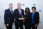 Brad Snyder, Enterprise Commodity Manager, BorgWarner (middle left), accepted a 2015 GM Supplier IMPACT Award from David Drouillard, GM Executive Director of Global Purchasing and Supply Chain (left), Michelle Sourie-Robinson, President & CEO of Michigan Minority Supplier Development Council (middle right) and Pollyette Lenear, GM Supplier Diversity Program Manager (right)
