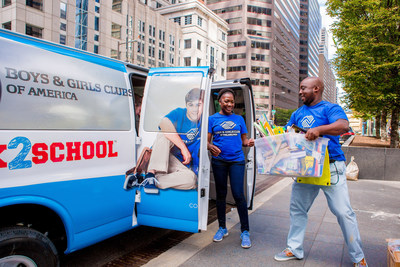 Boys & Girls Clubs of America and Comcast volunteers help Stuff the Bus during the organization's Back2School event.
