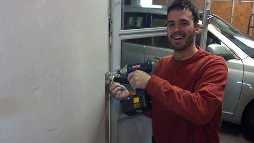 Inventor, Physical Therapist, Nick Hinkle installs a Flip A Grip.  (PRNewsFoto/Flip A Grip)