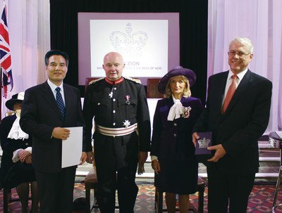 Pastor Kim Joo-Cheol receives the award certificate signed by Queen Elizabeth II and the commemorative crystal of the Queen's Award.