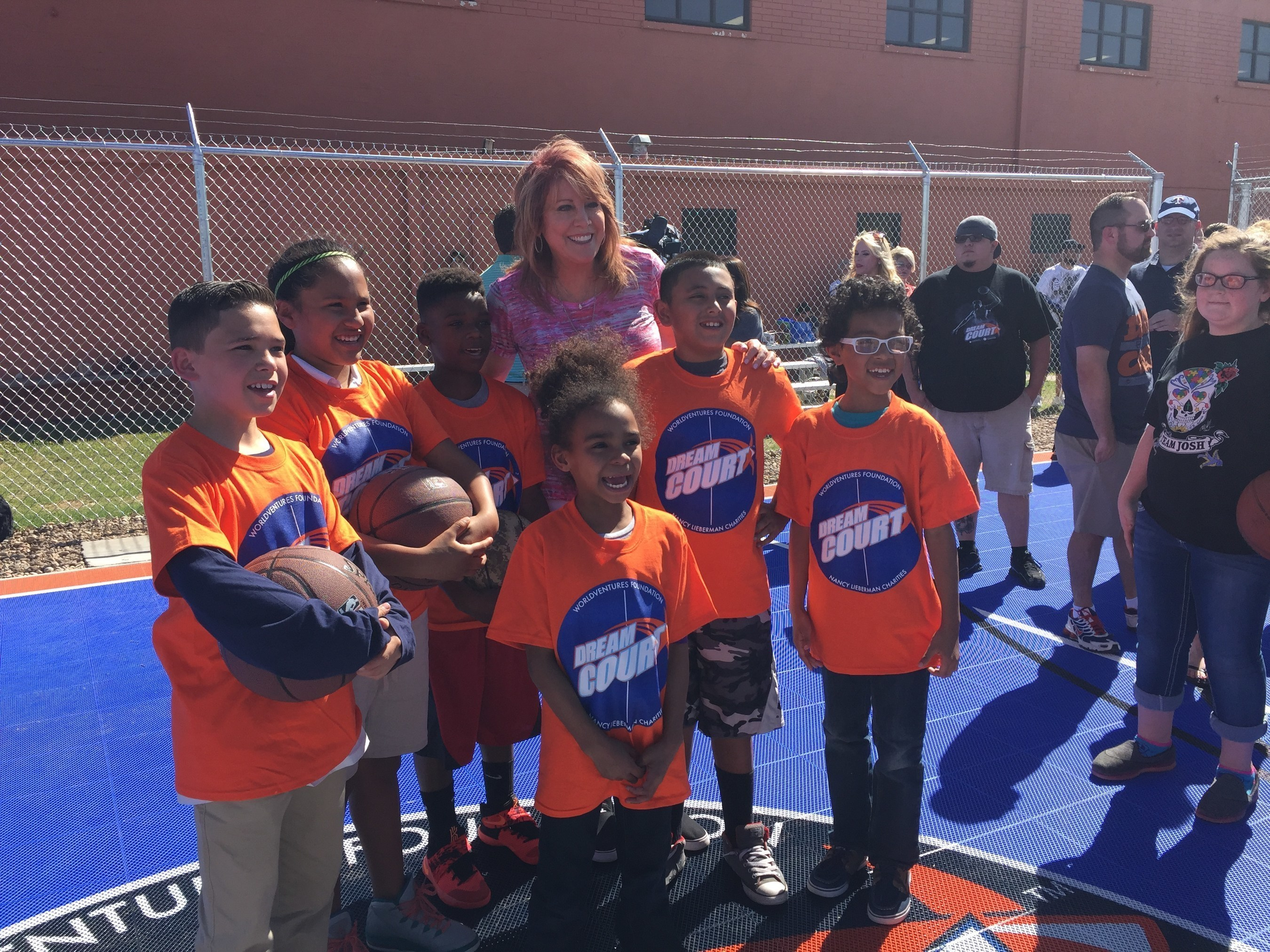 """Nancy Lieberman and members of the """"Maverick"""" Boys & Girls Clubs Amarillo and Canyon on new DreamCourt"""