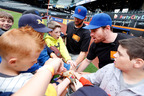 Mets players lead a team cheer at a #ShowYourStripes event at Citi Field. (PRNewsFoto/Kellogg Company)