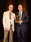 James Curtis (r), Vice President and Senior Counsel at Bank of the West, receiving the California Bankers Association's in-house banking attorney of the year award for 2015 from Steve Strange (l), Senior Vice President and General Counsel at Manufacturers Bank