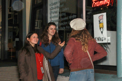 A volunteer explains to passerbys why posters are in storefronts in San Francisco. The posters are part of ...