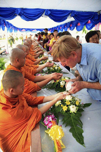 Another charming Songkran tradition is showing gratitude and respect to monks by pouring scented lustral water over their hands.  (PRNewsFoto/Tourism Authority of Thailand)