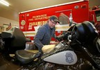 Bill Davidson, vice president of the Harley-Davidson Museum, washes a Milwaukee police motorcycle as other employees wash fire department vehicles in Milwaukee, Wisc. Harley-Davidson announced free Riding Academy motorcycle training to all U.S. first responders from January 1 to December 31, 2016.  (Jeffrey Phelps/AP Images for Harley-Davidson)