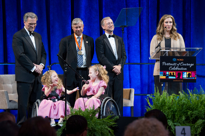 "Children with rare disease present award to Representative Fred Upton (MI) at NORD ""Portraits of Courage"" Celebration. (PRNewsFoto/NORD)"