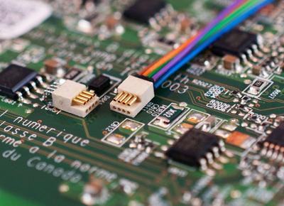 Omnetic's Nano-SMT PZN Connectors shown on circuit board.  (PRNewsFoto/Omnetics)