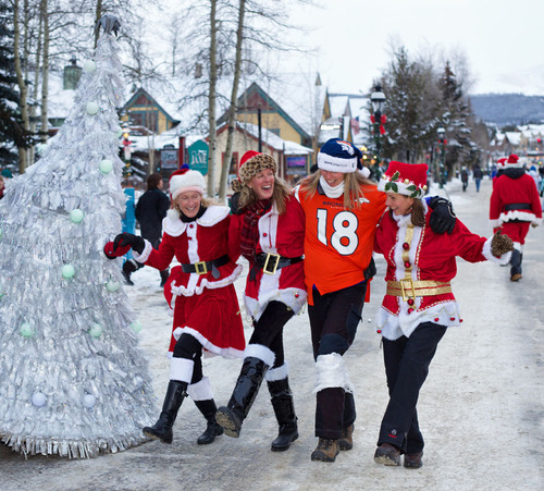 Participants in Race of the Santas in Breckenridge, Colo. dance their way down Main Street as part of the annual fun run supporting toy charity Adopt an Angel Summit County. The event, followed by the lighting of the town tree, raised funds to support happy holidays for more than 2,100 children since its inception in 2011. Holiday festivities continue through the month in Breckenridge, Colo. Daniel Dunn / GoBreck (PRNewsFoto/GoBreck) (PRNewsFoto/GOBRECK)