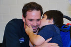 A kindergarten student at Plaza Towers Elementary shares some love with six-time NASCAR champion Jimmie Johnson during Johnson's visit to the school Thursday in Moore, Okla. Johnson teamed with Lowe's to fund the reconstruction of the school gyms at Plaza Towers, Highland East Junior High and Briarwood Elementary. All three gyms were destroyed by a tornado on May 20, 2013. (PRNewsFoto/Lowe's Companies, Inc.)