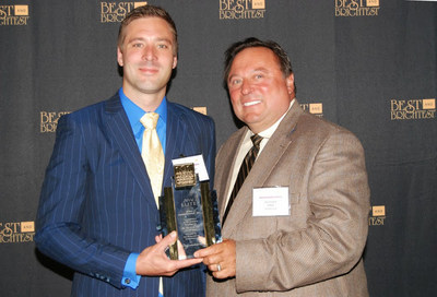 FONA President Luke Slawek and his father, CEO Joseph Slawek, accept the top honor at the Best & Brightest Companies to Work For ceremony, as FONA was named the Best Company to Work For in all of Chicago for the second time in four years by the NABR. FONA was also named Best Mid-Sized Company to Work For in the Nation in 2011 and 2013.