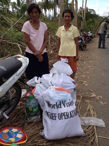 Emergency food, water and hygiene kits distributed to families on Cebu Island.  Photo credit:  World Vision.  ...