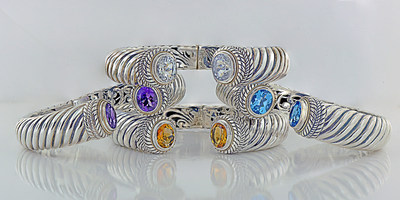 Perfect for Mother's Day. Handcrafted Sterling Silver and Gemstone bangles by Robert Manse Designs. Amethyst and Citrine bangles boast over 5 carats of gemstones. Blue Topaz and White Topaz have over 8 carats of top quality gemstones.