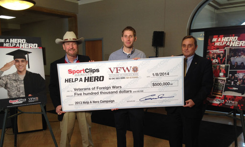 "Sport Clips Haircuts presents a $500,000 check to the Veterans of Foreign Wars' ""Sport Clips Help A ..."