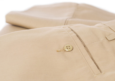 QUALITY CONSTRUCTION - One sign of a well-made pair of pants is the use of topstitches sewn parallel to a seam to help fabric facings stay in place; another indicator is button holes bound with thread for added durability.