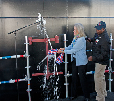 February 1, 2014 - Lyn Glenn christened the second Mobile Landing Platform (MLP) ship, USNS John Glenn, at the General Dynamics NASSCO shipyard in San Diego. The MLP 2 is named in honor of her father, famed Marine Corps Pilot, Congressional Space Medal of Honor recipient and four-term U.S. senator, the Honorable John Glenn.  The MLP 2 is the second of three MLP vessels designed and built by NASSCO.  The MLP will provide capability for large scale logistics movements such as transfer of vehicles and equipment from sea to shore when delivered to the Navy later this year.  (PRNewsFoto/General Dynamics NASSCO)