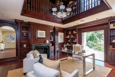 In 2009, the homeowners, renowned book collectors, built an addition to house their world-renowned collection of first editions. Inspired by Smathers' original plans, this open two-story Federal style library/office is floored in Brazilian cherry wood and paneled in rich African mahogany topped with striking dentil crown molding.