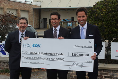 Dan Henson, regional vice president of operations for Cox Communications (center) presents a check to Jon Kagan, board chair for the YMCA of Northwest Florida (left), accompanied by Ashton Hayward, mayor of Pensacola (right).