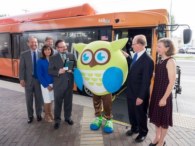"""Techolote,"" the BiblioTech mascot, is joined by (l. to r.) VIA Trustee Dr. Richard Gambitta, VIA Trustee Rebecca Q. Cedillo, and VIA President/CEO Jeffrey C. Arndt to celebrate the launch of the Ride & Read initiative in partnership with BiblioTech, Bexar County's digital library."