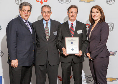 At a ceremony in Cobo Center, Vari-Form received the 2014 GM Supplier Quality Excellence Award. The award was presented by GM representatives Randall L Pappal, executive director (left) and Sheri Hickok, executive director (right). Accepting the award for Vari-Form were (l to r) Stephen Dow, president and Randy Nicholls, operations director.
